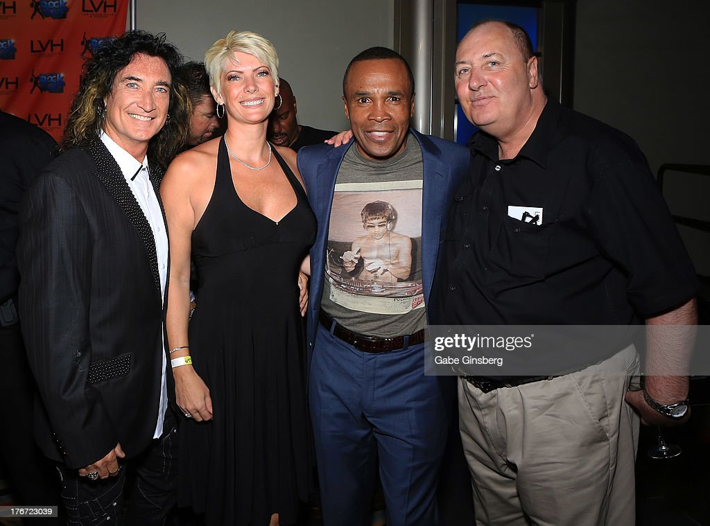 Singer Robin McAuley, Gina McAuley, former boxer Sugar Ray Leonard and Anthony McAuley arrive at the 'Night of the Champion' event to honor former boxer Leon Spinks hosted by the cast members of 'Raiding the Rock Vault' at The Las Vegas Hotel & Casino on August 17, 2013 in Las Vegas, Nevada.