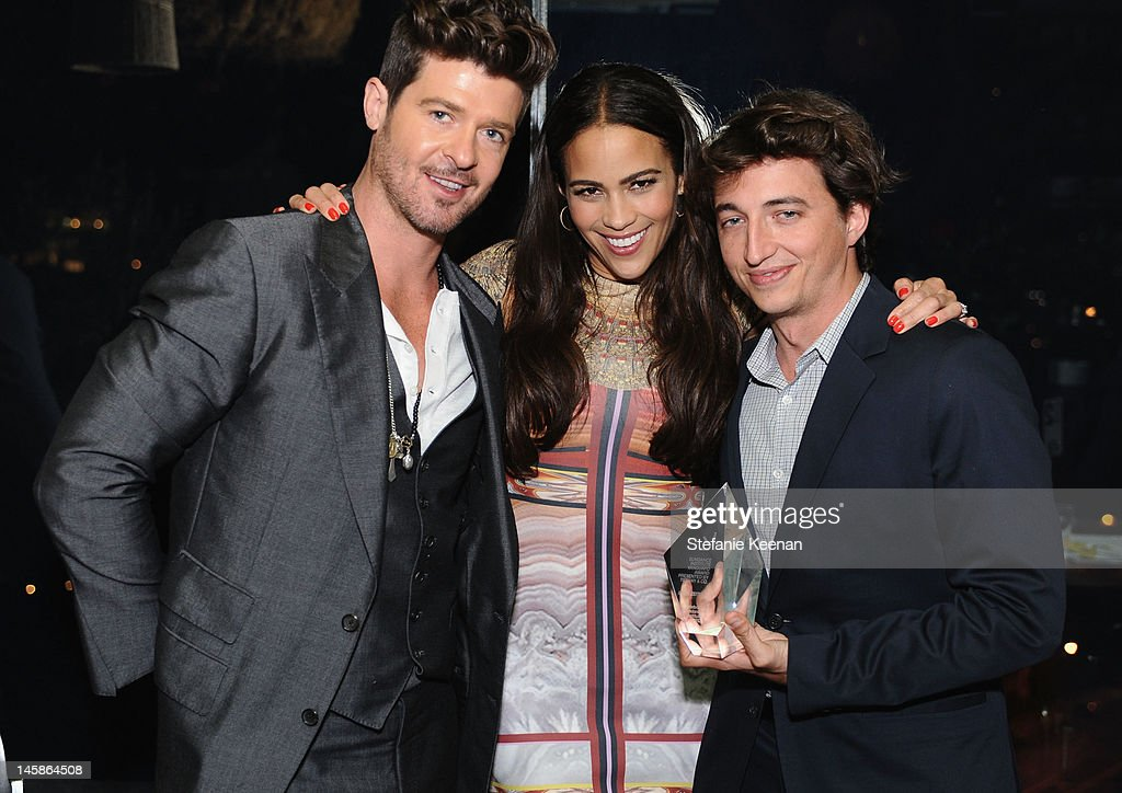 Singer <a gi-track='captionPersonalityLinkClicked' href=/galleries/search?phrase=Robin+Thicke&family=editorial&specificpeople=724390 ng-click='$event.stopPropagation()'>Robin Thicke</a>, actress <a gi-track='captionPersonalityLinkClicked' href=/galleries/search?phrase=Paula+Patton&family=editorial&specificpeople=752812 ng-click='$event.stopPropagation()'>Paula Patton</a> and Filmmaker <a gi-track='captionPersonalityLinkClicked' href=/galleries/search?phrase=Benh+Zeitlin&family=editorial&specificpeople=6711208 ng-click='$event.stopPropagation()'>Benh Zeitlin</a> attend the Sundance Institute Benefit presented by Tiffany & Co. in Los Angeles held at Soho House on June 6, 2012 in West Hollywood, California.