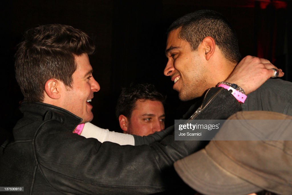 Singer <a gi-track='captionPersonalityLinkClicked' href=/galleries/search?phrase=Robin+Thicke&family=editorial&specificpeople=724390 ng-click='$event.stopPropagation()'>Robin Thicke</a> (L) and actor <a gi-track='captionPersonalityLinkClicked' href=/galleries/search?phrase=Wilmer+Valderrama&family=editorial&specificpeople=202028 ng-click='$event.stopPropagation()'>Wilmer Valderrama</a> attend the T-Mobile Presents Google Music at TAO, a nightlife event at the 2012 Sundance Film Festival on January 21, 2012 in Park City, Utah.