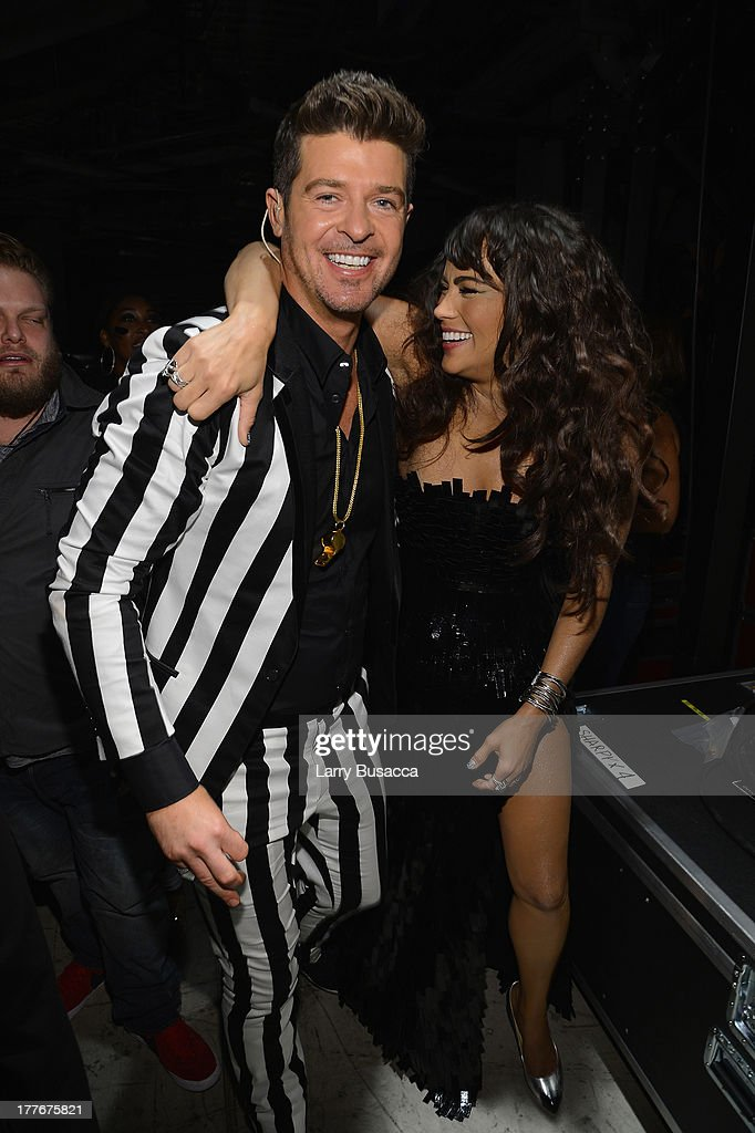 Singer Robin Thicke and actress Paula Patton (Detail: Lever Couture dress, David Yurman jewels, Giuseppe Zanotti shoes) attend the 2013 MTV Video Music Awards at the Barclays Center on August 25, 2013 in the Brooklyn borough of New York City.