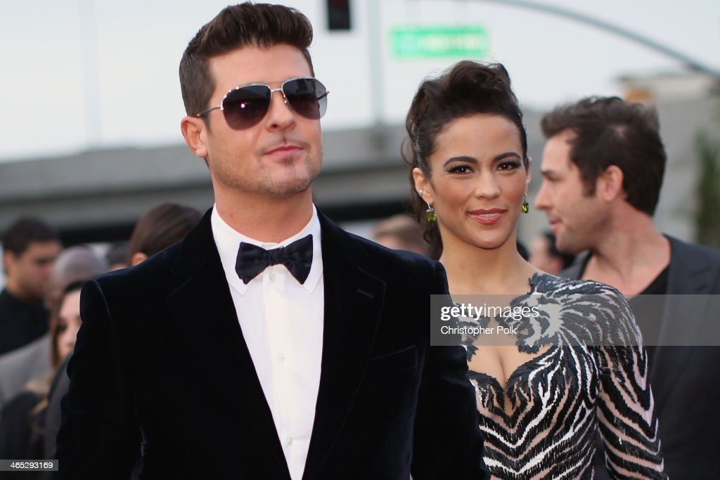 Singer <a gi-track='captionPersonalityLinkClicked' href=/galleries/search?phrase=Robin+Thicke&family=editorial&specificpeople=724390 ng-click='$event.stopPropagation()'>Robin Thicke</a> and actress <a gi-track='captionPersonalityLinkClicked' href=/galleries/search?phrase=Paula+Patton&family=editorial&specificpeople=752812 ng-click='$event.stopPropagation()'>Paula Patton</a> attend the 56th GRAMMY Awards at Staples Center on January 26, 2014 in Los Angeles, California.