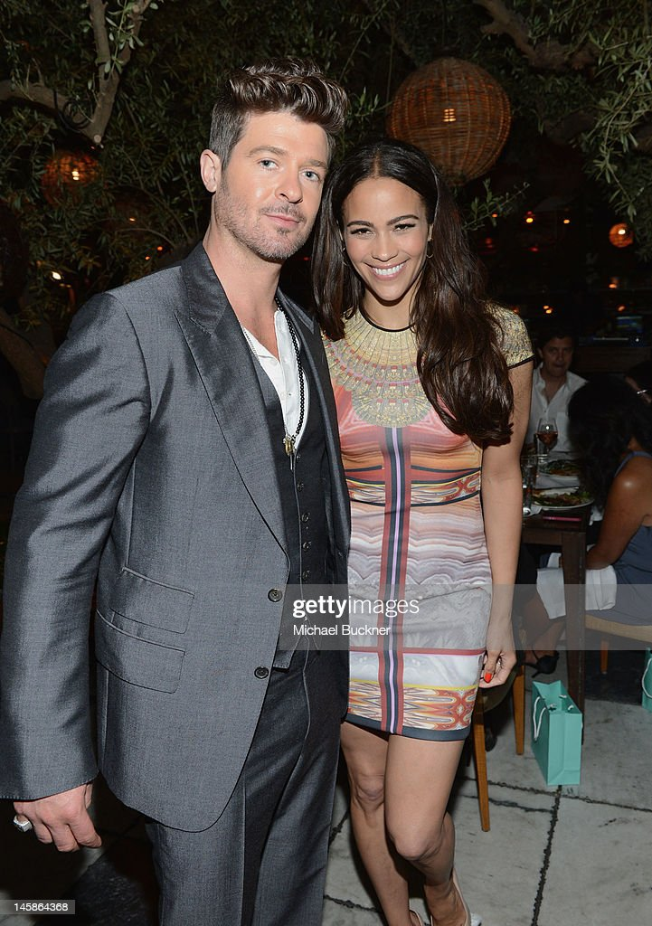 Singer <a gi-track='captionPersonalityLinkClicked' href=/galleries/search?phrase=Robin+Thicke&family=editorial&specificpeople=724390 ng-click='$event.stopPropagation()'>Robin Thicke</a> and actress <a gi-track='captionPersonalityLinkClicked' href=/galleries/search?phrase=Paula+Patton&family=editorial&specificpeople=752812 ng-click='$event.stopPropagation()'>Paula Patton</a> attend the Sundance Institute Benefit presented by Tiffany & Co. in Los Angeles held at Soho House on June 6, 2012 in West Hollywood, California.