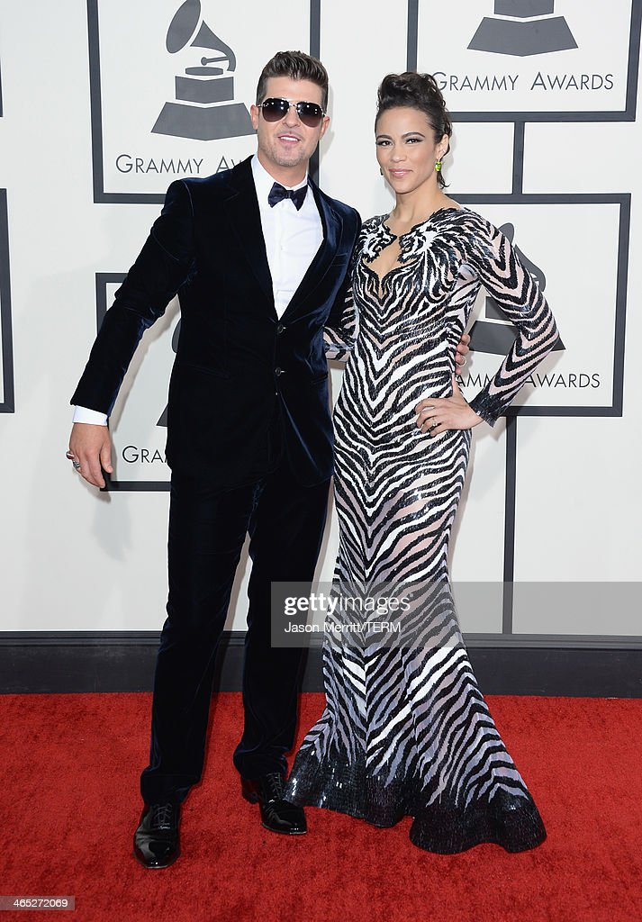 Singer Robin Thicke (L) and actress Paula Patton attends the 56th GRAMMY Awards at Staples Center on January 26, 2014 in Los Angeles, California.