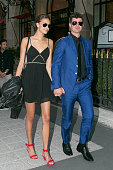 Singer Robin Thicke and girlfriend April Love Geary are seen leaving the 'Plaza Athenee' hotel on September 11 2015 in Paris France