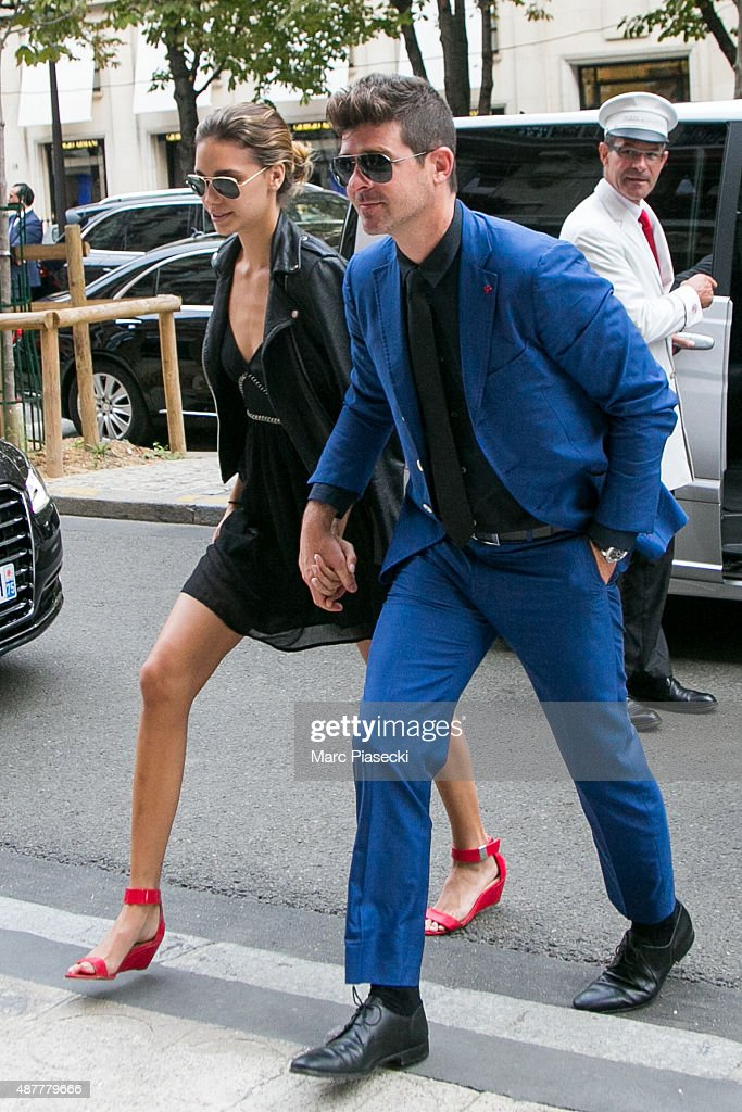 Singer Robin Thicke and girlfriend April Love Geary arrive at the 'Plaza Athenee' hotel on September 11 2015 in Paris France