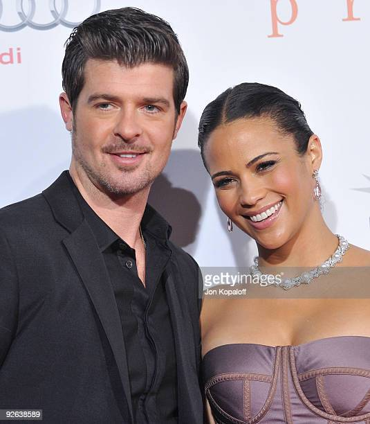 Singer Robin Thicke and wife actress Paula Patton arrive at the Los Angeles Premiere 'Precious Based On The Novel Push By Sapphire' at Grauman's...