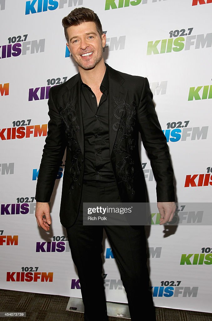 Singer <a gi-track='captionPersonalityLinkClicked' href=/galleries/search?phrase=Robin+Thicke&family=editorial&specificpeople=724390 ng-click='$event.stopPropagation()'>Robin Thicke</a> attends KIIS FM's Jingle Ball 2013 at Staples Center on December 6, 2013 in Los Angeles, CA.
