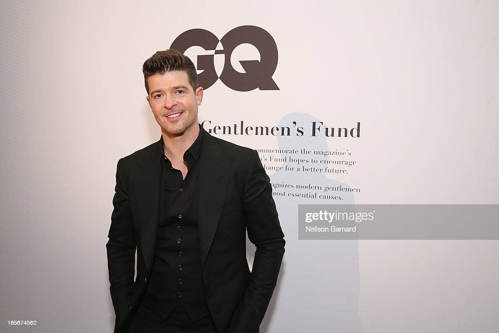 Singer <a gi-track='captionPersonalityLinkClicked' href=/galleries/search?phrase=Robin+Thicke&family=editorial&specificpeople=724390 ng-click='$event.stopPropagation()'>Robin Thicke</a> attends the 2013 GQ Gentlemen's Ball presented by BMW i, Movado, and Nautica at IAC Building on October 23, 2013 in New York City.