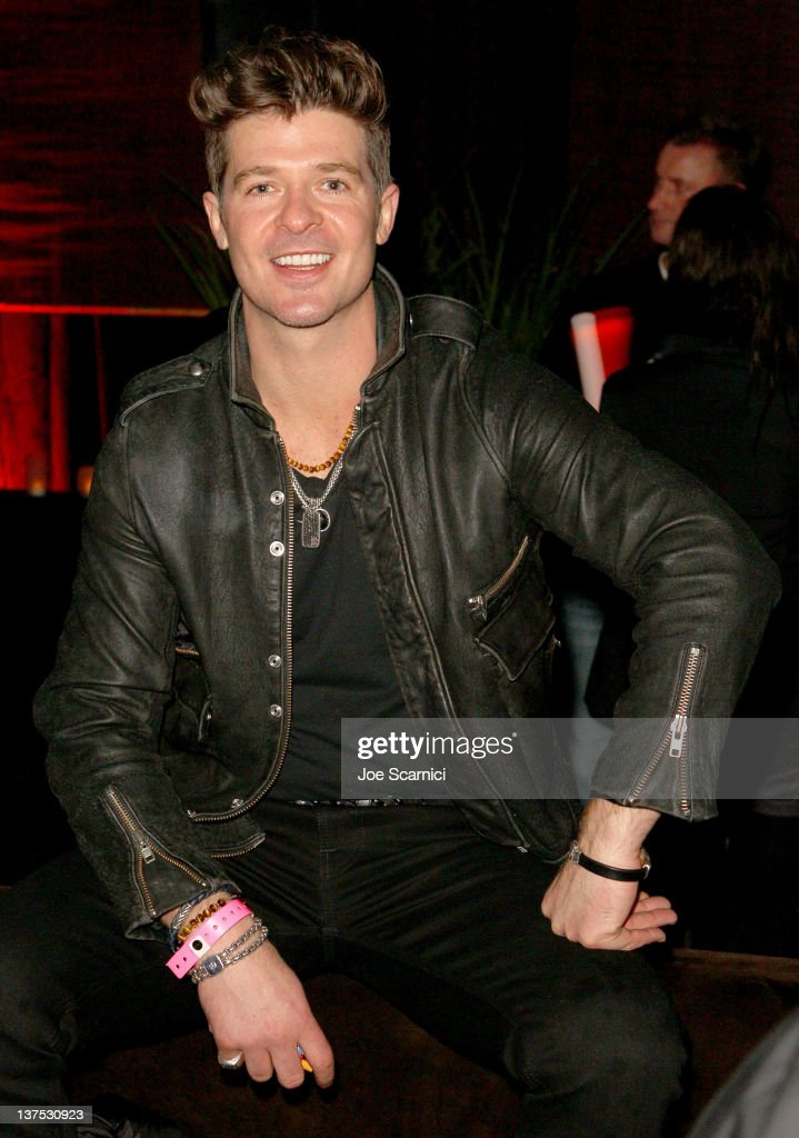 Singer <a gi-track='captionPersonalityLinkClicked' href=/galleries/search?phrase=Robin+Thicke&family=editorial&specificpeople=724390 ng-click='$event.stopPropagation()'>Robin Thicke</a> attends the T-Mobile Presents Google Music at TAO, a nightlife event at the 2012 Sundance Film Festival on January 21, 2012 in Park City, Utah.