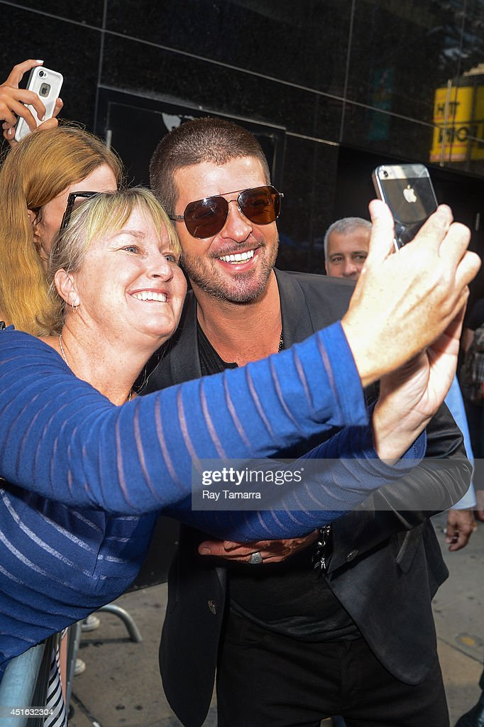 Singer Robin Thicke leaves the 'Good Morning America' taping at the ABC Times Square Studios on July 02, 2014 in New York City.