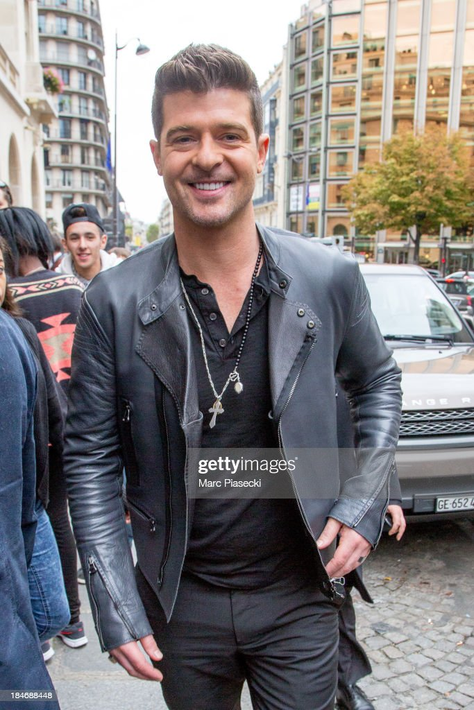 Singer <a gi-track='captionPersonalityLinkClicked' href=/galleries/search?phrase=Robin+Thicke&family=editorial&specificpeople=724390 ng-click='$event.stopPropagation()'>Robin Thicke</a> leaves the Hotel De Sers on October 15, 2013 in Paris, France.