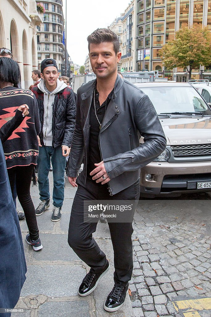 Singer Robin Thicke leaves the Hotel De Sers on October 15, 2013 in Paris, France.