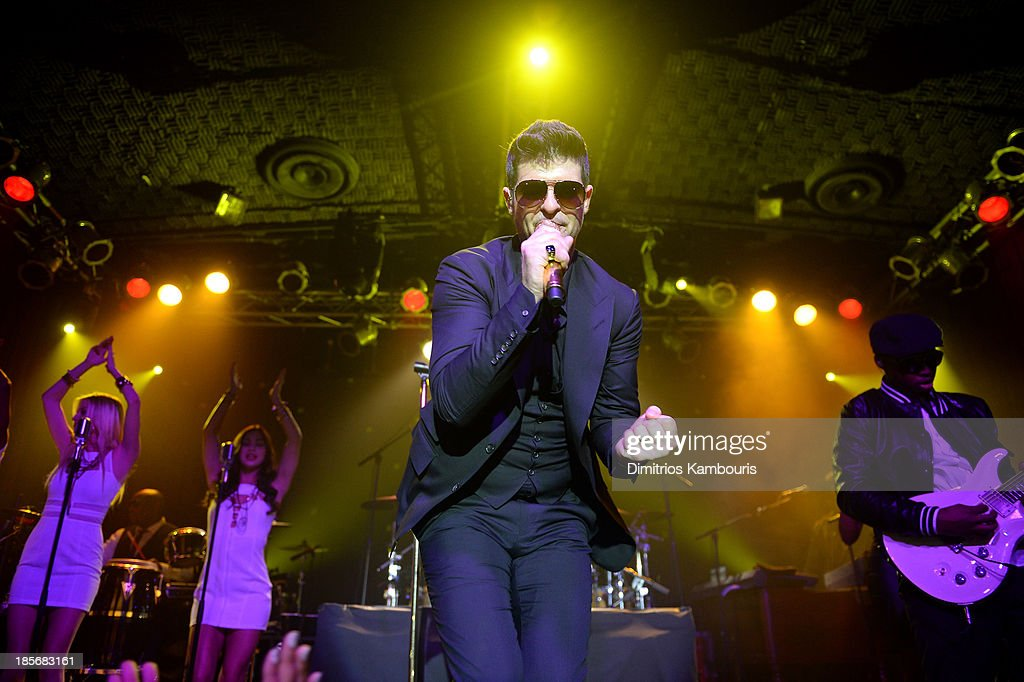 Singer <a gi-track='captionPersonalityLinkClicked' href=/galleries/search?phrase=Robin+Thicke&family=editorial&specificpeople=724390 ng-click='$event.stopPropagation()'>Robin Thicke</a> performs at the 2013 GQ Gentlemen Give Back Concert with <a gi-track='captionPersonalityLinkClicked' href=/galleries/search?phrase=Robin+Thicke&family=editorial&specificpeople=724390 ng-click='$event.stopPropagation()'>Robin Thicke</a> at Highline Ballroom on October 23, 2013 in New York City.