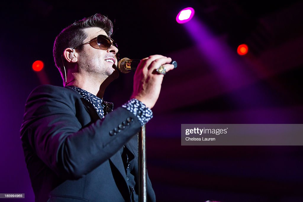 Singer <a gi-track='captionPersonalityLinkClicked' href=/galleries/search?phrase=Robin+Thicke&family=editorial&specificpeople=724390 ng-click='$event.stopPropagation()'>Robin Thicke</a> performs at the 97.1 AMP radio Halloween masquerade at Hollywood Palladium on October 26, 2013 in Hollywood, California.