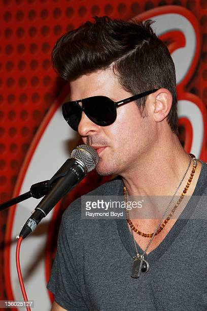 Singer Robin Thicke performs in the V103FM 'CocaCola Lounge' in Chicago Illinois on DECEMBER 13 2011