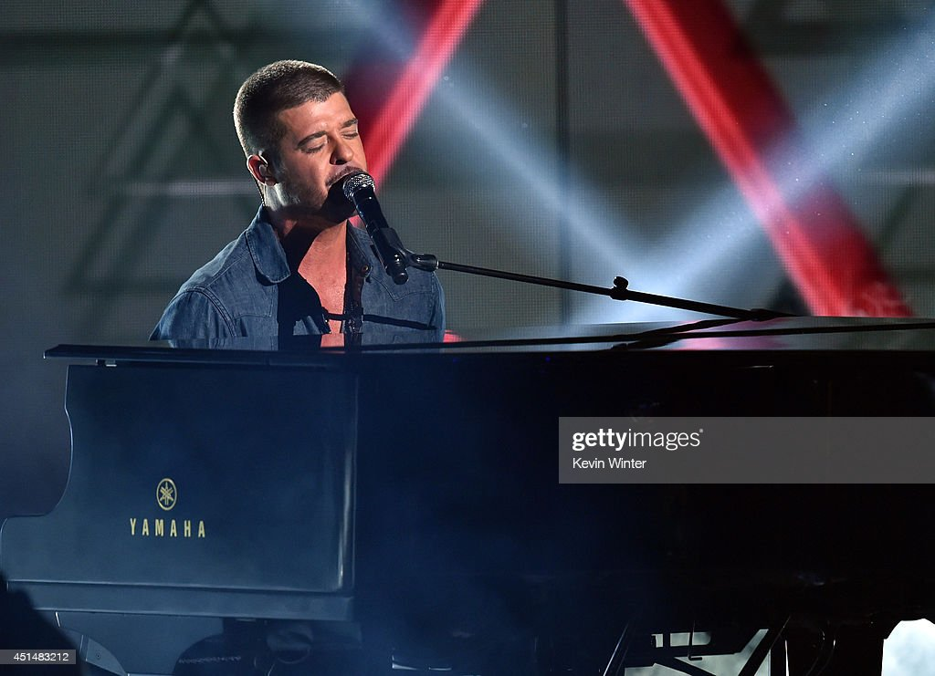 Singer <a gi-track='captionPersonalityLinkClicked' href=/galleries/search?phrase=Robin+Thicke&family=editorial&specificpeople=724390 ng-click='$event.stopPropagation()'>Robin Thicke</a> performs onstage during the BET AWARDS '14 at Nokia Theatre L.A. LIVE on June 29, 2014 in Los Angeles, California.