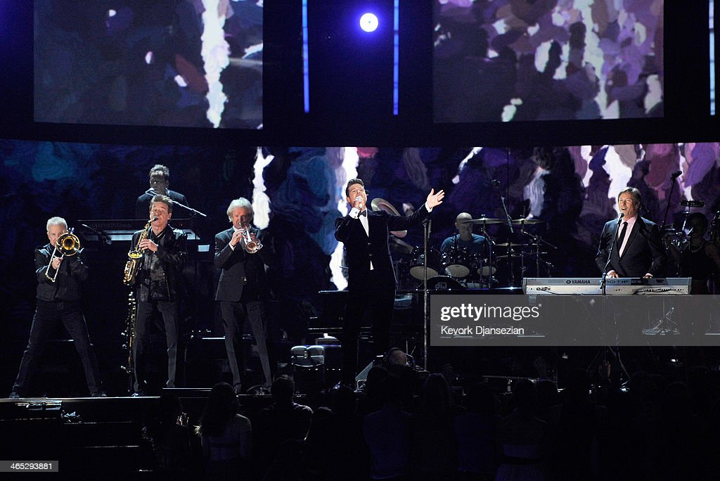 Singer Robin Thicke (C) performs with Chicago onstage during the 56th GRAMMY Awards at Staples Center on January 26, 2014 in Los Angeles, California.