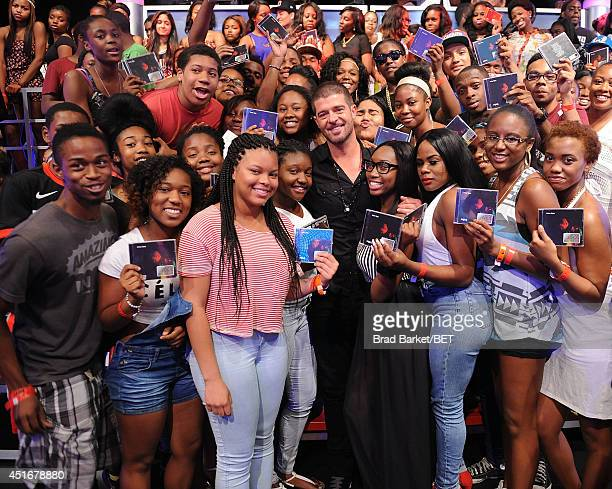 Singer Robin Thicke poses with fans as he attends BET 106 and Park on July 1 2014 in New York City
