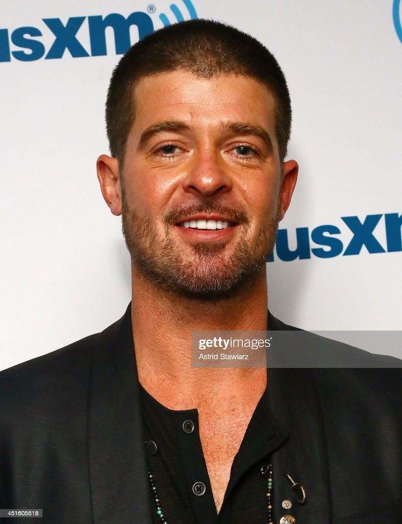 Singer <a gi-track='captionPersonalityLinkClicked' href=/galleries/search?phrase=Robin+Thicke&family=editorial&specificpeople=724390 ng-click='$event.stopPropagation()'>Robin Thicke</a> visits the SiriusXM Studios on July 2, 2014 in New York City.