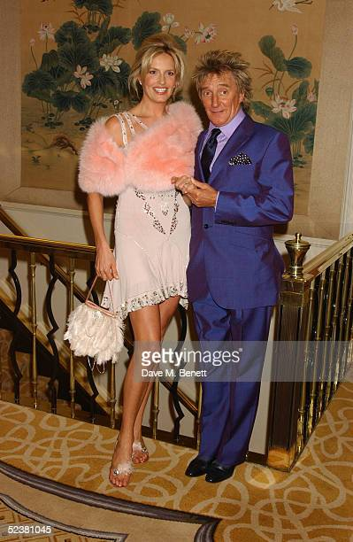 Singer Rod Stewart and actress Penny Lancaster pose after announcing their engagement at the Savoy Hotel March 12 2005 in London England