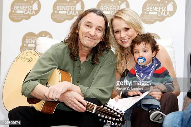 Singer Roger Hodgson and tv host actress Nova Meierhenrich and Noah attend the press conference of the 7th McDonald's Charity Gala at the Station on...