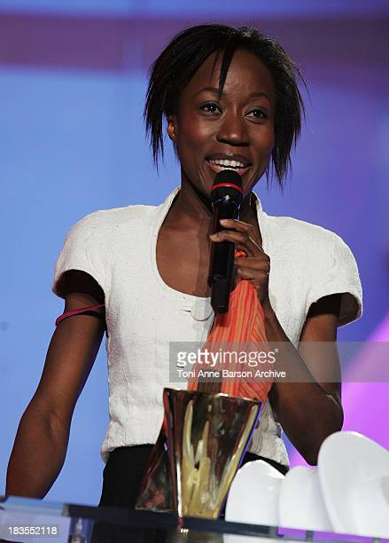 Singer Rokia Traore reacts on stage as she receives Award for best World Music album of the year during the Les Victoires de la Musique at the Le...