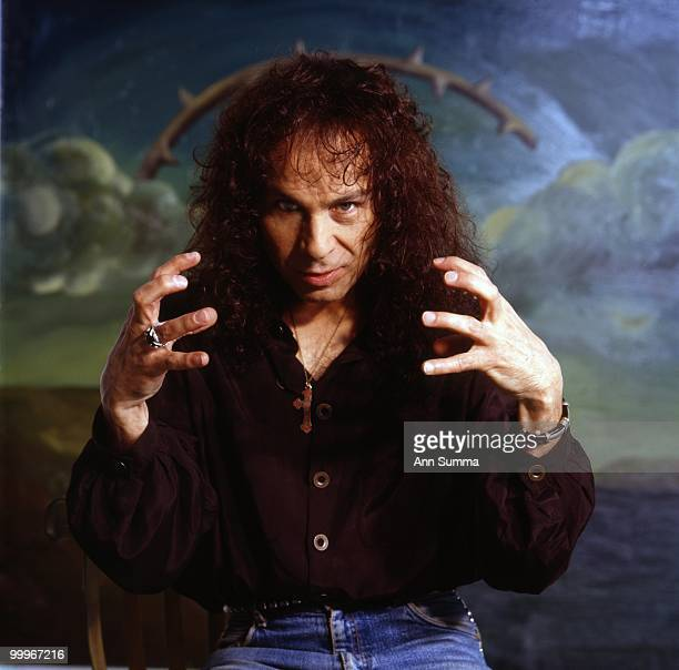Singer Ronnie James Dio poses for a portrait in front of a painting by Manuel Ocampo on April 10 1990 in Los Angeles California
