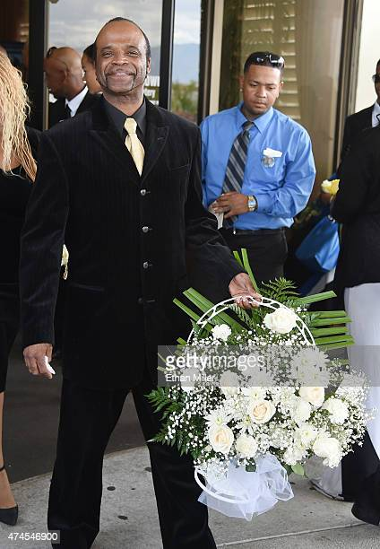 Singer Roy Hamilton Jr carries flowers as he leaves a funeral for blues musician BB King at Palm Downtown Mortuary Cemetery on May 23 2015 in Las...