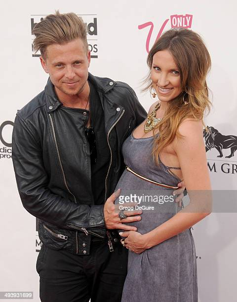Singer Ryan Tedder and Genevieve Tedder arrive at the 2014 Billboard Music Awards at the MGM Grand Garden Arena on May 18 2014 in Las Vegas Nevada