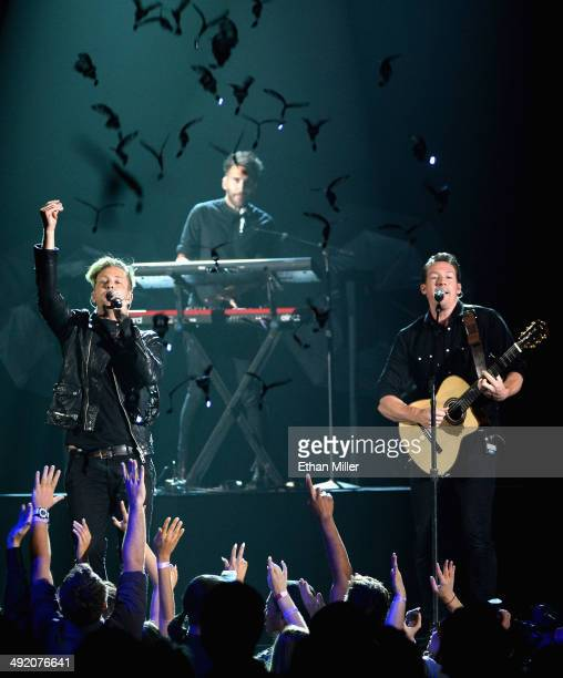 Singer Ryan Tedder and guitarist Zach Filkins of OneRepublic perform onstage during the 2014 Billboard Music Awards at the MGM Grand Garden Arena on...