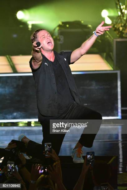 Singer Ryan Tedder of OneRepublic performs during the OneRepublic With Fitz The Tantrums And James Arthur In Concert show at PNC Bank Arts Center on...