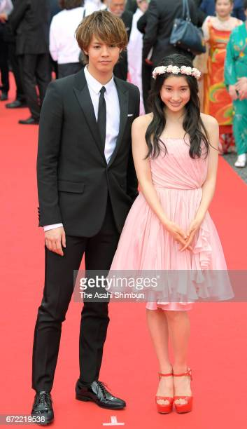 Singer Ryota Katayose and actress Tao Tsuchiya walk on the red carpet during the closing ceremony of the 9th Okinawa International Movie Festival on...
