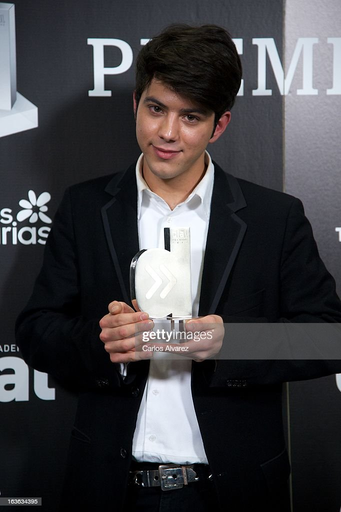 Singer Salvador Bletran holds his 'Cadena Dial' award during the Cadena Dial awards 2013 at the Adan Martin auditorium on March 13, 2013 in Tenerife, Spain.