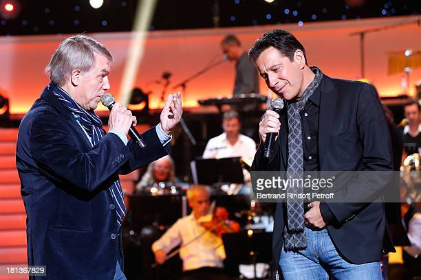 Singer Salvatore Adamo and humorist Laurent Gerra imitating Joe Dassin perform at 'Le Grand Show' by Laurent Gerra Rehearsal at La Plaine Saint Denis...