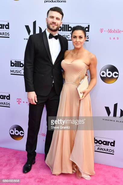 Singer Sam Hunt and Hannah Lee Fowler attend the 2017 Billboard Music Awards at TMobile Arena on May 21 2017 in Las Vegas Nevada