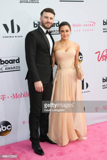 Singer Sam Hunt and Hannah Lee Fowler attend the 2017 Billboard Music Awards at the TMobile Arena on May 21 2017 in Las Vegas Nevada