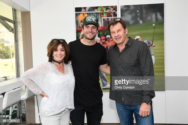 Singer Sam Hunt poses with Nick Faldo and his partner during a meet and greet at the Patriots Outpost during previews prior to the start of THE...