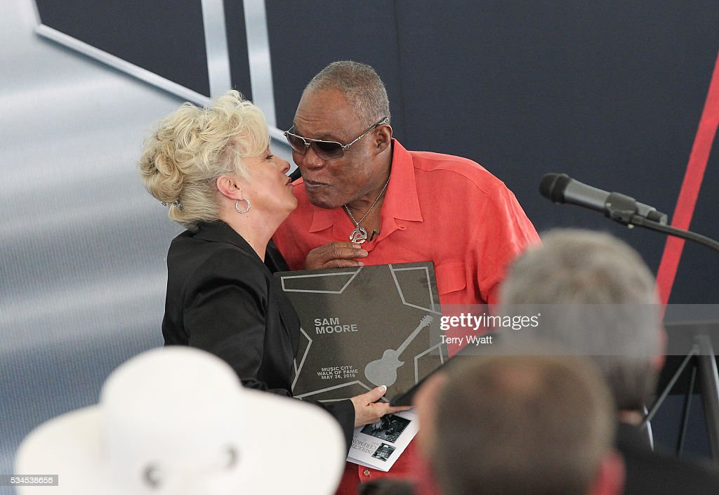 Singer <a gi-track='captionPersonalityLinkClicked' href=/galleries/search?phrase=Sam+Moore&family=editorial&specificpeople=828179 ng-click='$event.stopPropagation()'>Sam Moore</a> is inducted into the Music City Walk Of Fame by Musical Artist <a gi-track='captionPersonalityLinkClicked' href=/galleries/search?phrase=Connie+Smith&family=editorial&specificpeople=4305189 ng-click='$event.stopPropagation()'>Connie Smith</a> at the 2016 Induction Ceremony at Walk of Fame Park on May 26, 2016 in Nashville, Tennessee.
