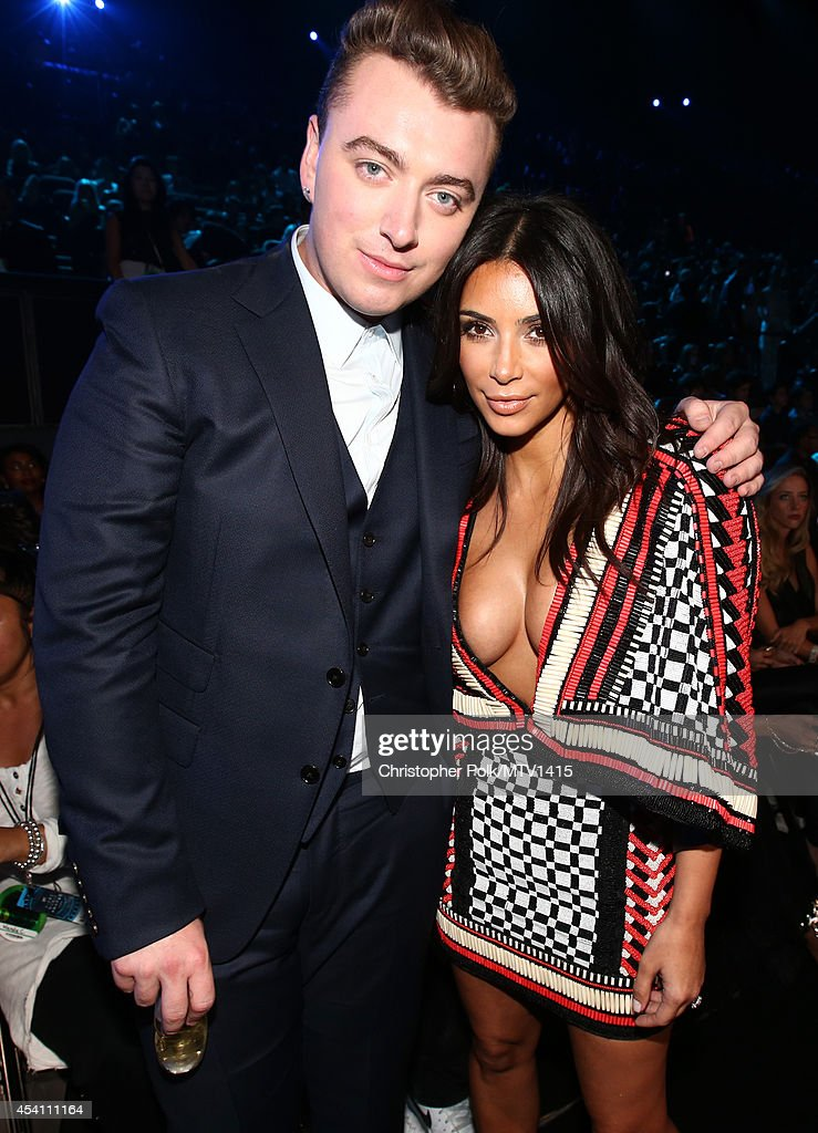 Singer <a gi-track='captionPersonalityLinkClicked' href=/galleries/search?phrase=Sam+Smith+-+Singer&family=editorial&specificpeople=12336931 ng-click='$event.stopPropagation()'>Sam Smith</a> (L) and TV personality <a gi-track='captionPersonalityLinkClicked' href=/galleries/search?phrase=Kim+Kardashian&family=editorial&specificpeople=753387 ng-click='$event.stopPropagation()'>Kim Kardashian</a> attend the 2014 MTV Video Music Awards at The Forum on August 24, 2014 in Inglewood, California.
