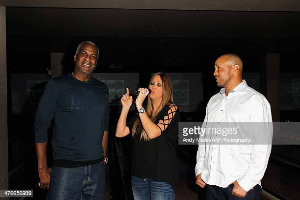 Singer Samantha Cole sings happy birthday to former NBA player Charles Oakley on his 50th birthday as former NBA player John Starks looks on during...