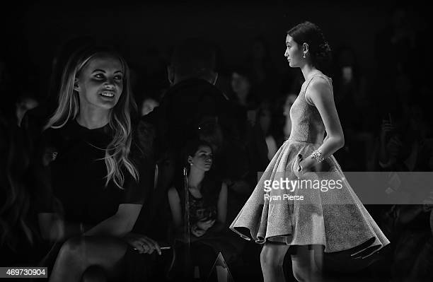 Singer Samantha Jade looks on as models showcase designs during the Steven Khalil Show at MercedesBenz Fashion Week Australia 2015 at Carriageworks...