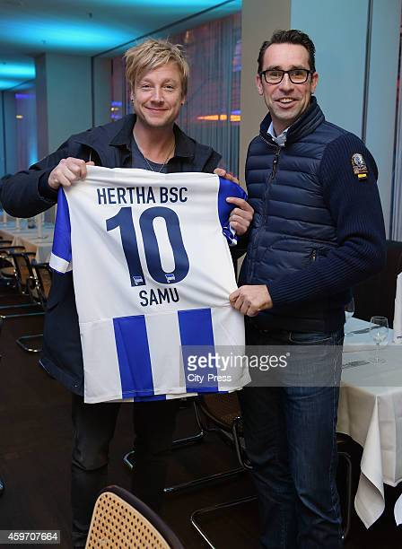Singer Samu Haber and CEO Michael Preetz of Hertha BSC pose for photographs the prior to the Bundesliga match between Hertha BSC and Bayern Muenchen...