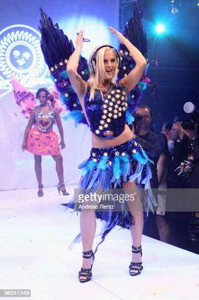 Singer Sandy Moelling of the pop group No Angels runs down the runway during the Lambertz Monday Night Schoko Fashion party at the Alten Wartesaal on...