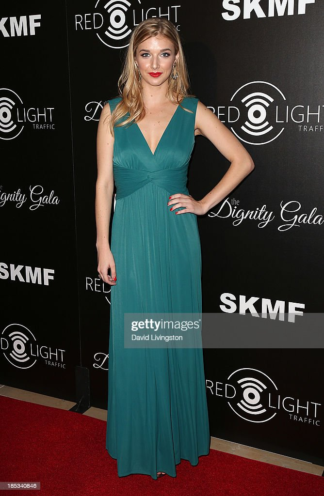 Singer Sarah Blaine attends the launch of the Redlight Traffic app at the Dignity Gala at The Beverly Hilton Hotel on October 18, 2013 in Beverly Hills, California.