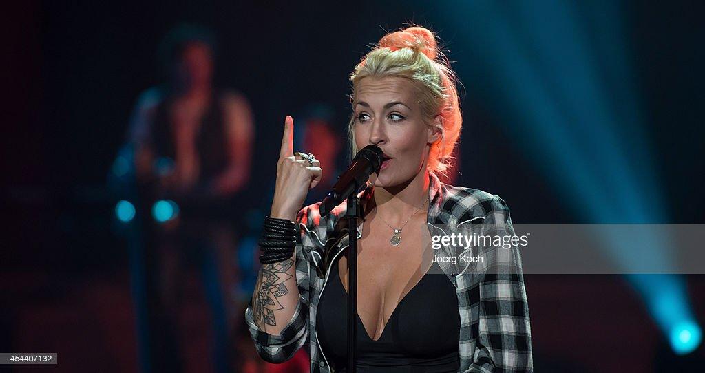 Singer Sarah Conner performs during the TVShow 'Gabalier Die VolksRock'n'RollShow' on August 30 2014 in Fuessen Germany