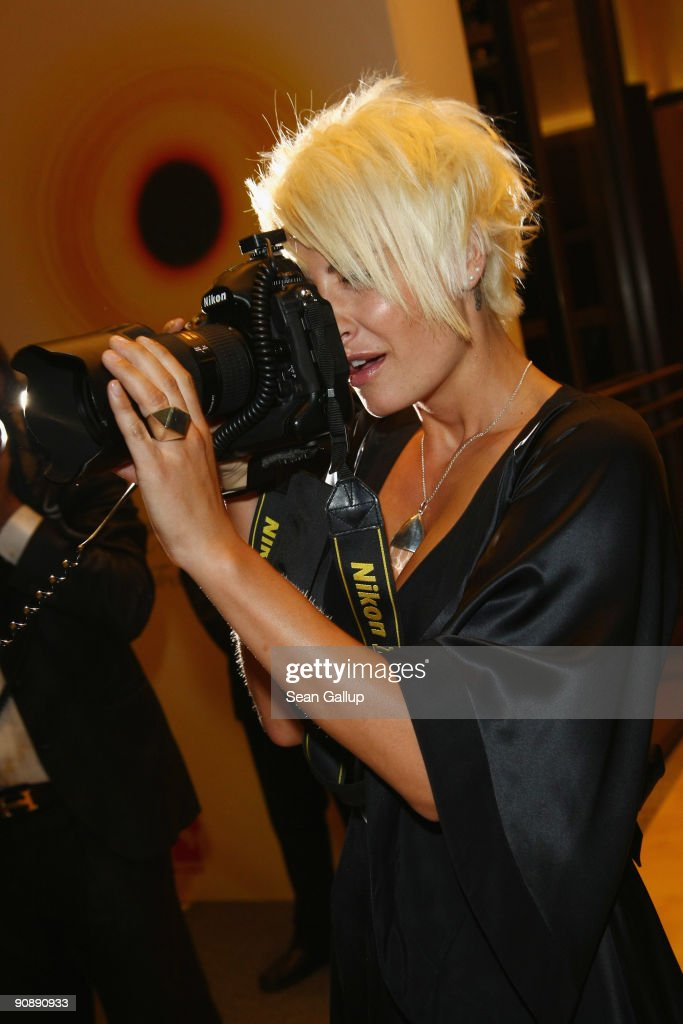 Singer Sarah Connor takes a photographer's camera as she attends the dreamball 2009 charity gala at the RitzCarlton on September 17 2009 in Berlin...