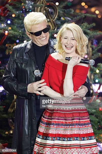 US singer Sarah Jane Scott and german singer Heino perform at the tv show 'Die schoensten Weihnachtshits' on November 30 2016 in Munich Germany