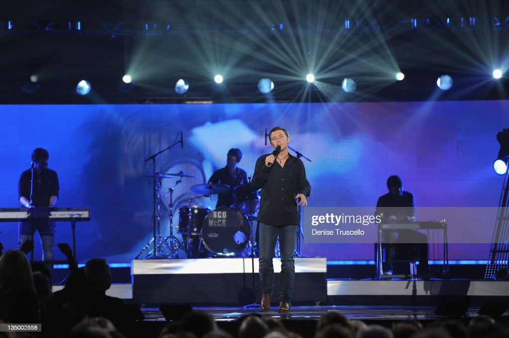 Singer Scott McCreery performs onstage during the 2011 American Country Awards at MGM Grand Garden Arena on December 5, 2011 in Las Vegas, Nevada.
