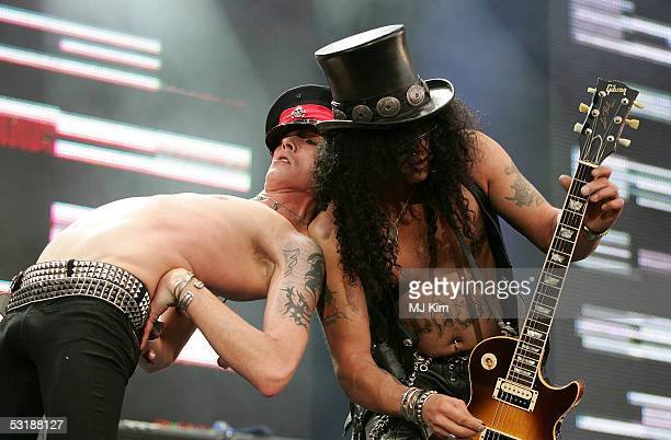 Singer Scott Weiland and guitarist Slash from the band Velvet Revolver perform on stage at 'Live 8 London' in Hyde Park on July 2 2005 in London...