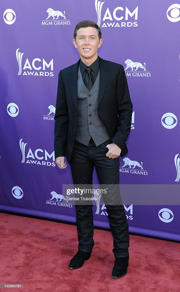 Singer <a gi-track='captionPersonalityLinkClicked' href=/galleries/search?phrase=Scotty+McCreery&family=editorial&specificpeople=7520936 ng-click='$event.stopPropagation()'>Scotty McCreery</a> arrives at the 47th Annual Academy Of Country Music Awards held at the MGM Grand Garden Arena on April 1, 2012 in Las Vegas, Nevada.